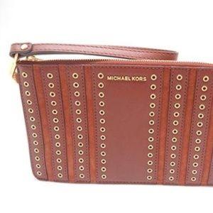 c8ac1f0ed8edb1 Michael Kors. M. K. Brooklyn Grommet Leather Wristlet Hndbag